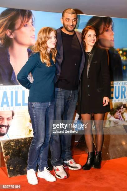 Isabelle Carre Ramzy Bedia Maria Duplaa attend the 'Une Vie Ailleurs' Paris Premiere at UGC Cine Cite des Halles on March 20 2017 in Paris France