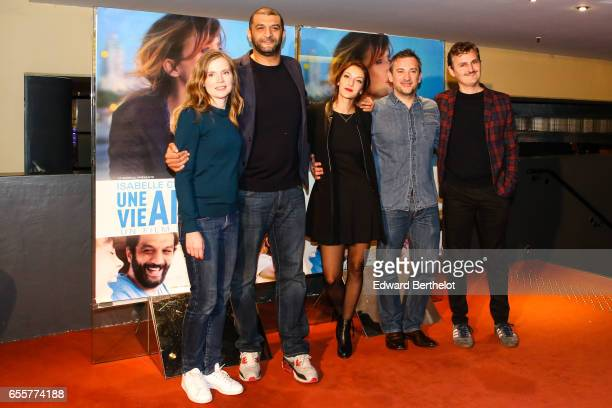 Isabelle Carre Ramzy Bedia Maria Duplaa Olivier Peyon and Olivier Ruidavet attend the 'Une Vie Ailleurs' Paris Premiere at UGC Cine Cite des Halles...