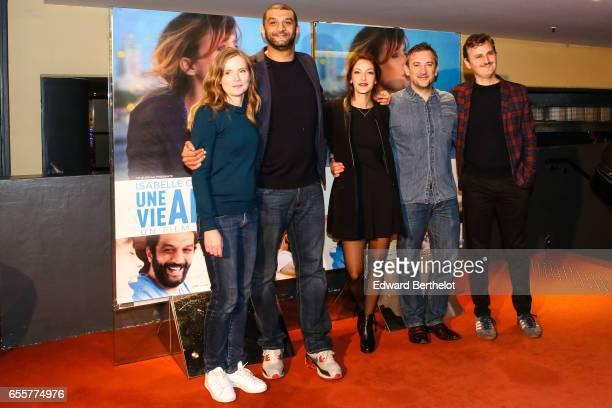Isabelle Carre Ramzy Bedia Maria Duplaa Olivier Peyon and Olivier Ruidavet attend the 'Une Vie Ailleurs' Paris Premiere at UGC Cine Cite des Halles...