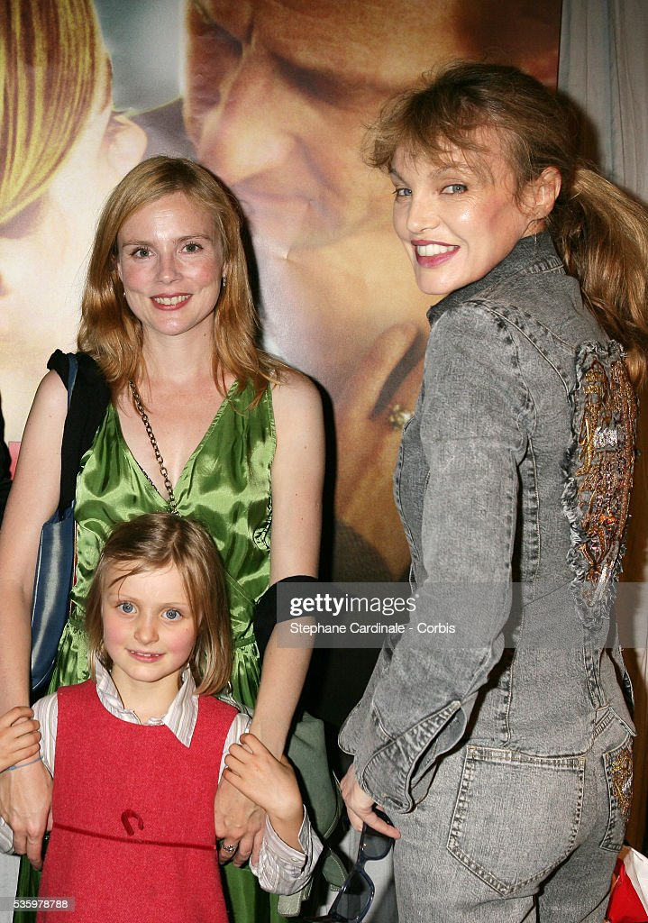 Isabelle Carre with Agathe Louvieaux (the daughter of Isabelle in the movie) and Arielle Dombasle attend the premiere of 'Entre ses mains' in Paris.