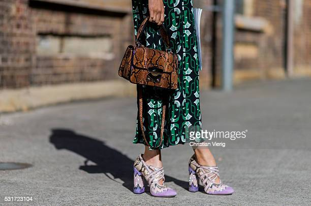Isabelle Cornish wearing a green Miu Miu dress brown bag and pink heels outside Ginger Smart at MercedesBenz Fashion Week Resort 17 Collections at...