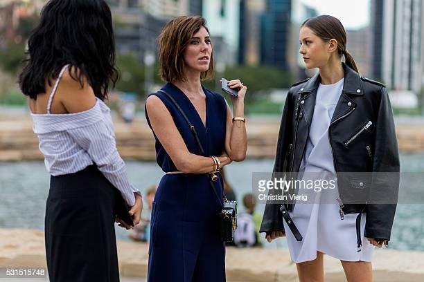 Isabelle Cornish wearing a white Toni Maticevski dress a black Burberry leather jacket outside Toni Maticevski at MercedesBenz Fashion Week Resort 17...