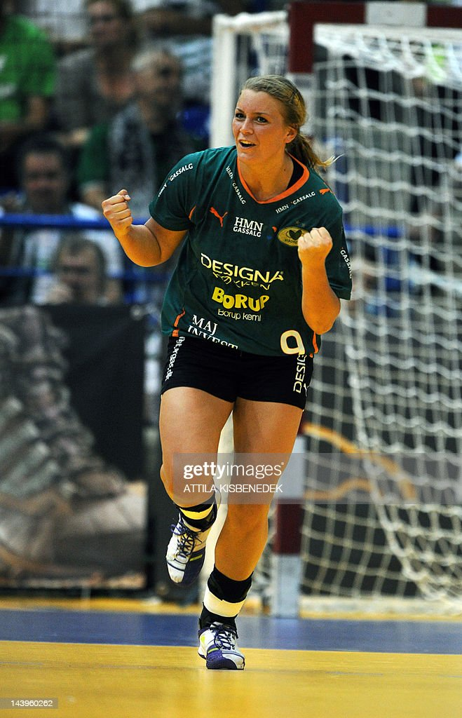 Isabelle Gullden of Danish HK Viborg celebrates scoring against Hungarian FTC Rail Cargo on May 6, 2012 during their EHF Cupwinners' Cup final handball match, first leg at the Diego sports hall in Dabas.