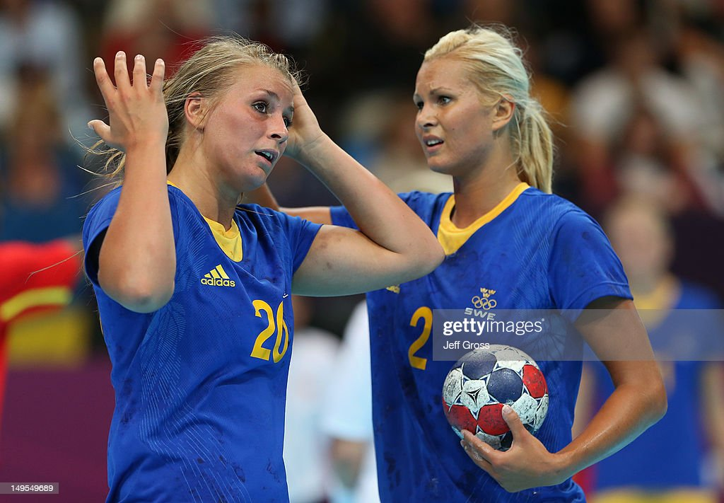 Isabelle Gullden of Sweden and Ulrika Agren of Sweden look on during the Women's Handball Preliminaries Group B - Match 12 between Sweden and Norway on Day 3 of the London 2012 Olympic Games at the Copper Box on July 30, 2012 in London, England.