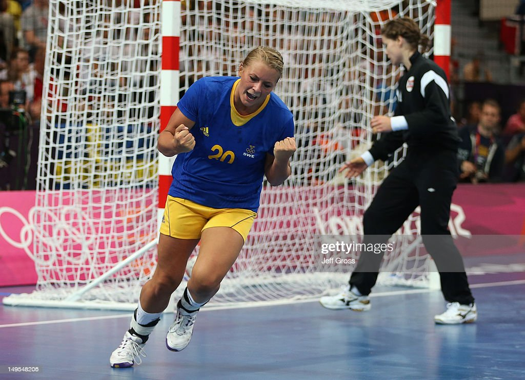 <a gi-track='captionPersonalityLinkClicked' href=/galleries/search?phrase=Isabelle+Gullden&family=editorial&specificpeople=4651166 ng-click='$event.stopPropagation()'>Isabelle Gullden</a> of Sweden celebrates scoring in the first half during the Women's Handball Preliminaries Group B - Match 12 between Sweden and Norway on Day 3 of the London 2012 Olympic Games at the Copper Box on July 30, 2012 in London, England.
