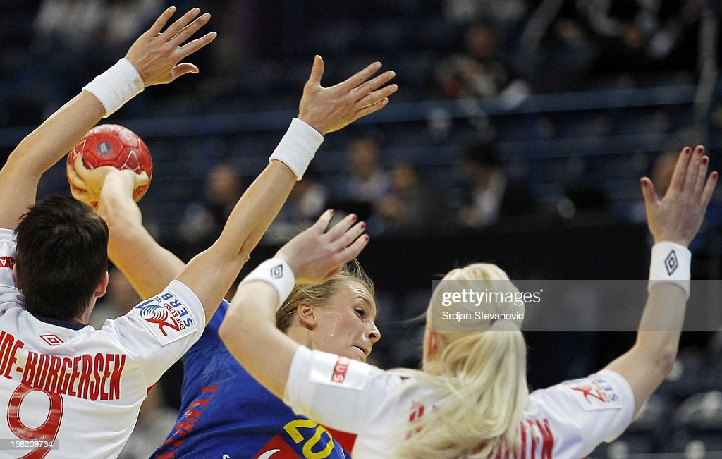 Isabelle Gullden (C) of Sweden in action against Kristine Lunde-Borgersen (L) of Norway during the Women's European Handball Championship 2012 Group I main round match between Norway and Sweden at Arena Hall on December 11, 2012 in Belgrade, Serbia.