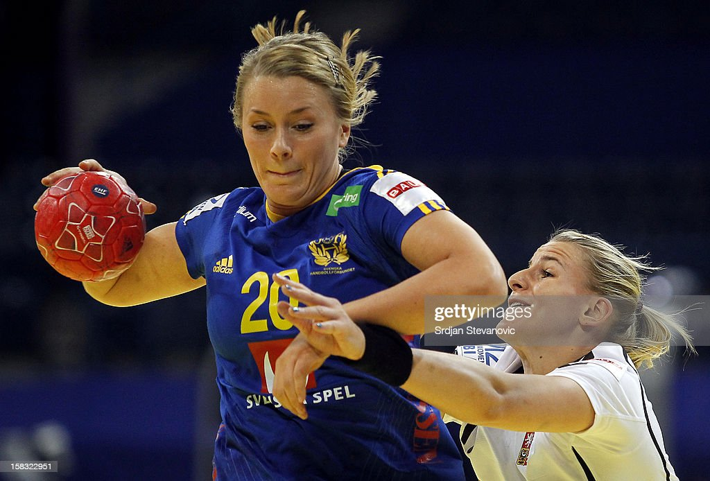 Isabelle Gullden (L) of Sweden is challenged by Helena Sterbova (R) of Czech Republic during the Women's European Handball Championship 2012 Group I main round match between Czech Republic and Sweden at Arena Hall on December 13, 2012 in Belgrade, Serbia.