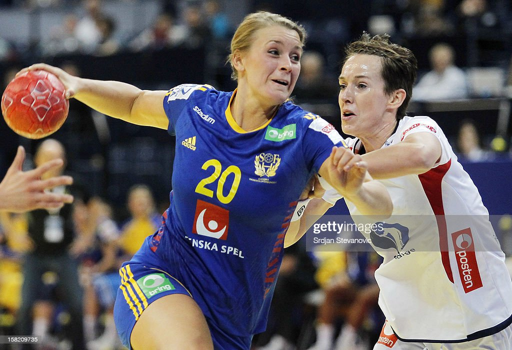 Isabelle Gullden (L) of Sweden is challenged by Kristine Lunde-Borgersen (R) of Norway during the Women's European Handball Championship 2012 Group I main round match between Norway and Sweden at Arena Hall on December 11, 2012 in Belgrade, Serbia.