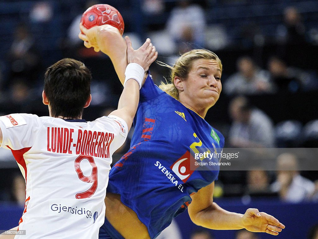 Isabelle Gullden (R) of Sweden is challenged by Kristine Lunde-Borgersen (L) of Norway during the Women's European Handball Championship 2012 Group I main round match between Norway and Sweden at Arena Hall on December 11, 2012 in Belgrade, Serbia.