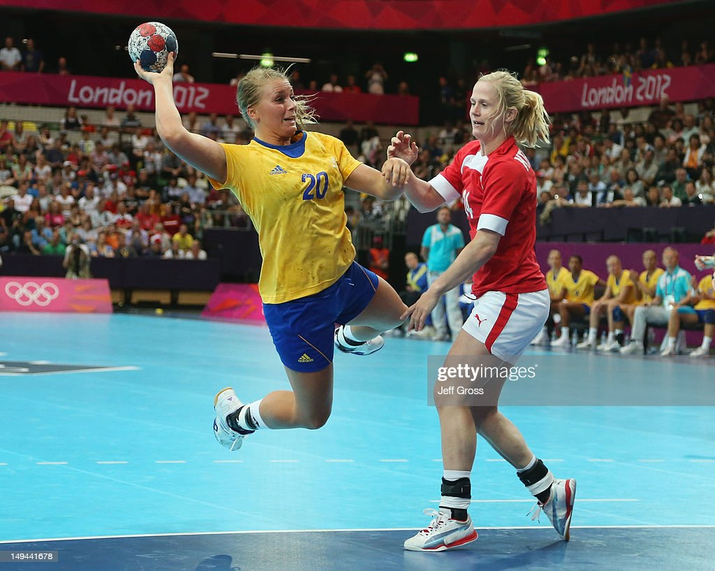 Isabelle Gullden of Sweden shoots and scores a goal in the Women's Handball preliminaries Group B - Match 4 between Denmark and Sweden on Day 1 of the London 2012 Olympic Games at the Copper Box on July 28, 2012 in London, England.