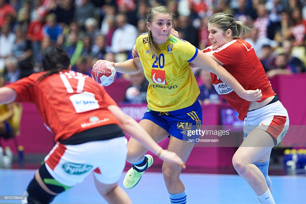 Isabelle Gulldén of Sweden challenge for the ball during the 22nd IHF Women's Handball World Championship Eight Final match between Denmark and Sweden in Jyske Bank Boxen on December 13, 2015 in Herning, Denmark.