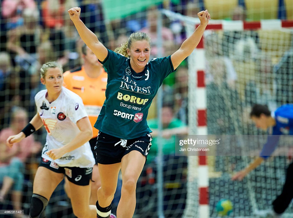 Isabelle Gulldén of Viborg HK celebrate after goal during the Danish Handball Liga match between Viborg HK and FC Midtjylland in Viborg Stadionhal on September 27, 2014 in Viborg, Denmark.
