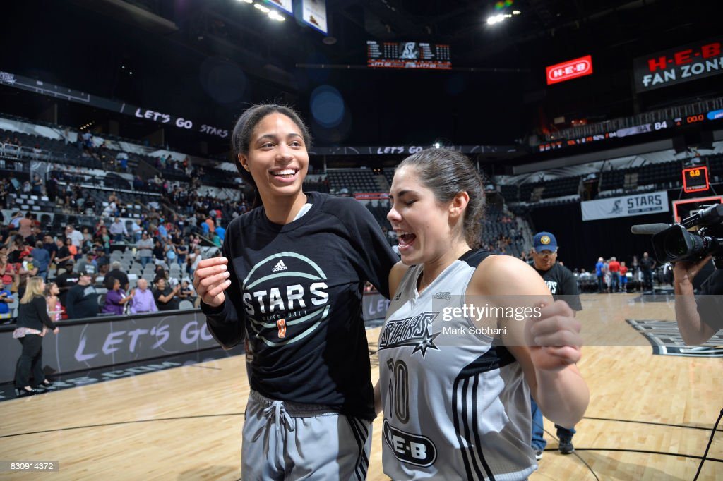 Isabelle Harrison #20 and Kelsey Plum #10 of the San Antonio Stars celebrate a win against the Atlanta Dream on August 12, 2017 at the AT&T Center in San Antonio, Texas.