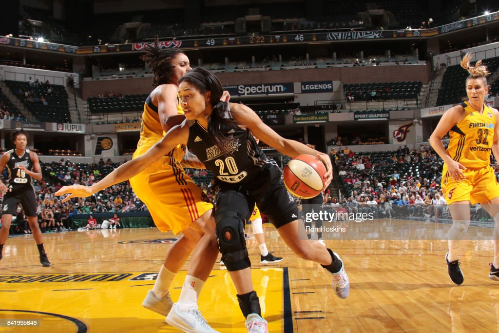 Isabelle Harrison #20 of the San Antonio Stars handles the ball against the Indiana Fever on September 2, 2017 at Bankers Life Fieldhouse in Indianapolis, Indiana.