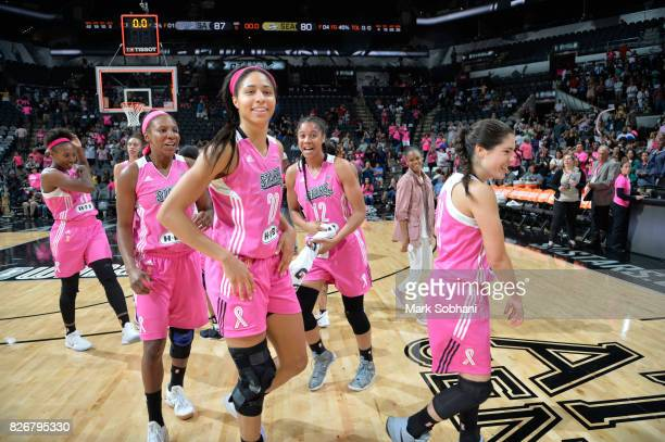 Isabelle Harrison Shay Murphy Nia Coffey and Kelsey Plum of the San Antonio Stars celebrate a win against the Seattle Storm on August 5 2017 at the...
