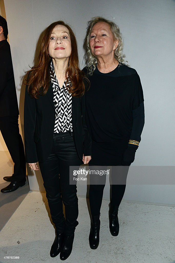 <a gi-track='captionPersonalityLinkClicked' href=/galleries/search?phrase=Isabelle+Huppert&family=editorial&specificpeople=662796 ng-click='$event.stopPropagation()'>Isabelle Huppert</a>, and Agnes B. attend the Agnes B. show as part of the Paris Fashion Week Womenswear Fall/Winter 2014-2015 at Palais de Tokyo on March 4, 2014 in Paris, France.