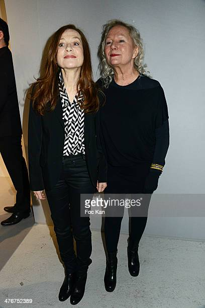 Isabelle Huppert and Agnes B attend the Agnes B show as part of the Paris Fashion Week Womenswear Fall/Winter 20142015 at Palais de Tokyo on March 4...