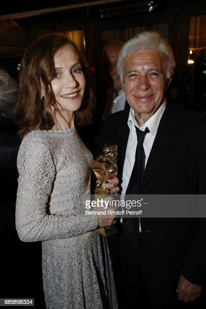 Isabelle Huppert and Guy Bedos attend the Dinner of 'La Nuit des Molieres 2017' at la Closerie des Lilas on May 29 2017 in Paris France