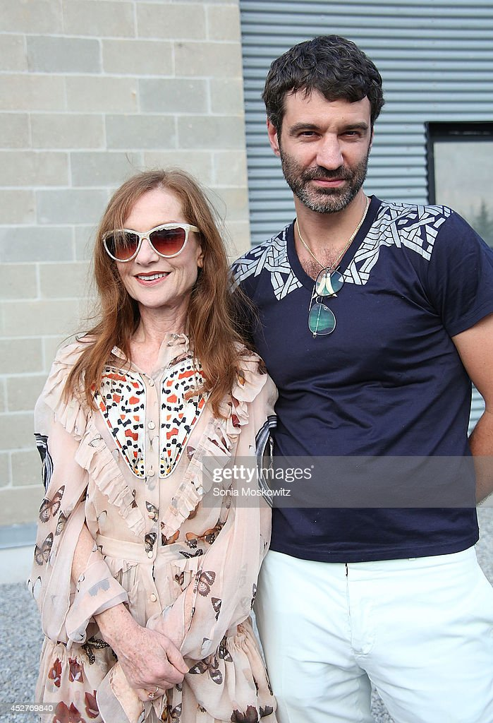 <a gi-track='captionPersonalityLinkClicked' href=/galleries/search?phrase=Isabelle+Huppert&family=editorial&specificpeople=662796 ng-click='$event.stopPropagation()'>Isabelle Huppert</a> and Jorn Weisbrodt attend the 21st Annual Watermill Summer Benefit at The Watermill Center on July 26, 2014 in Water Mill, New York.