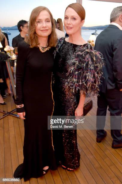 Isabelle Huppert and Julianne Moore attend the Vanity Fair and HBO Dinner celebrating the Cannes Film Festival at Hotel du CapEdenRoc on May 20 2017...