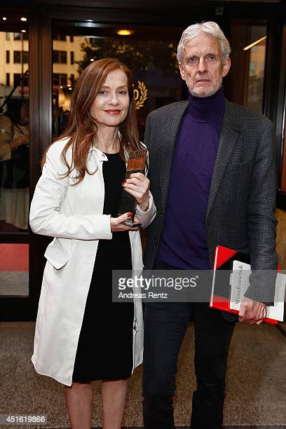 Isabelle Huppert and Mathieu Carriere attend the Cine Merit Award as part of Filmfest Muenchen at Sendlinger Tor on July 2 2014 in Munich Germany