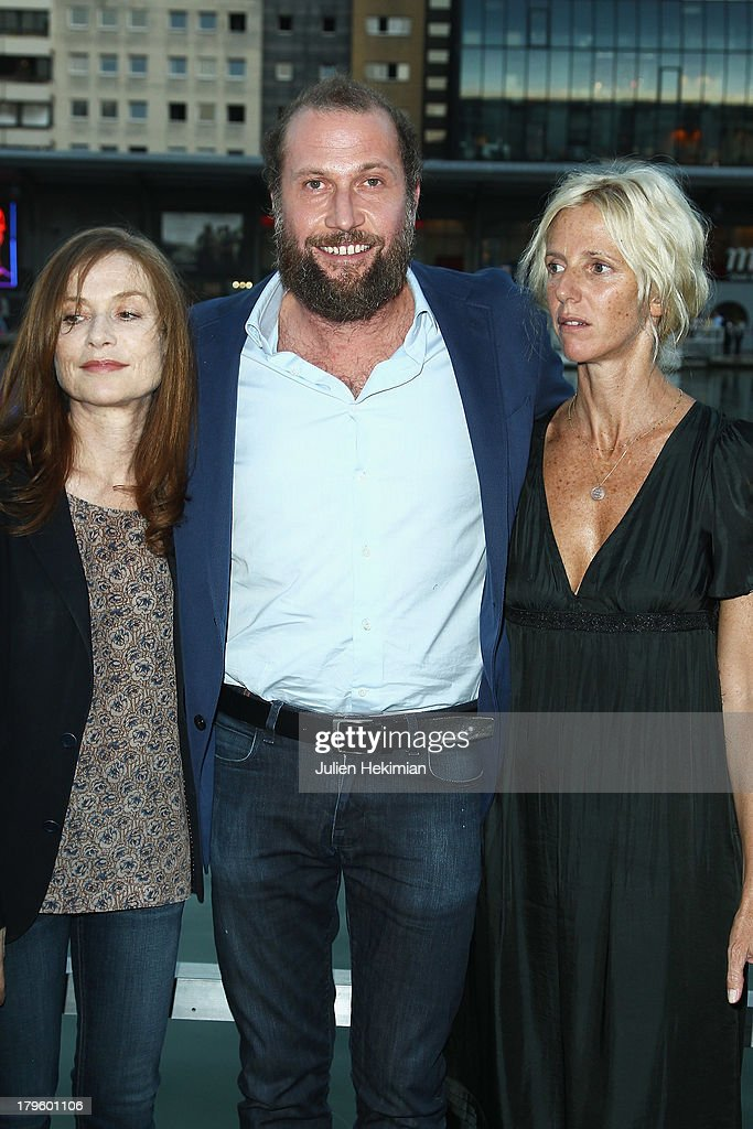 <a gi-track='captionPersonalityLinkClicked' href=/galleries/search?phrase=Isabelle+Huppert&family=editorial&specificpeople=662796 ng-click='$event.stopPropagation()'>Isabelle Huppert</a>, Francois Damiens and <a gi-track='captionPersonalityLinkClicked' href=/galleries/search?phrase=Sandrine+Kiberlain&family=editorial&specificpeople=832890 ng-click='$event.stopPropagation()'>Sandrine Kiberlain</a> attend 'Tip Top' Paris Premiere at Mk2 Quai de Seine on September 5, 2013 in Paris, France.