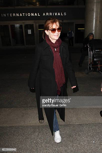 Isabelle Huppert is seen at LAX on November 11 2016 in Los Angeles California