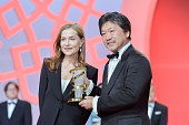 Isabelle Huppert presents Hirokazu Koreeda a tribute award during the 14th Marrakech International Film Festival on December 9 2014 in Marrakech...