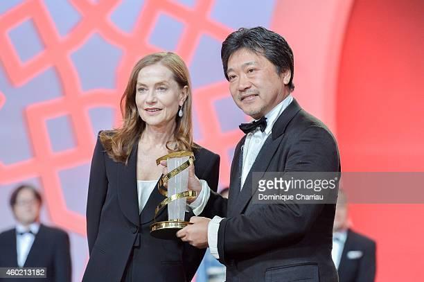 Isabelle Huppert presents Hirokazu Koreeda a tribute award during the 14th Marrakech International Film Festival on December 9 2014 in Marrakech...