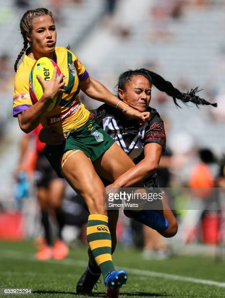 Isabelle Kelly of the Jillaroos looks to beat the tackle of Alexandra Cook of the Kiwi Ferns during the 2017 Auckland Nines match between the...