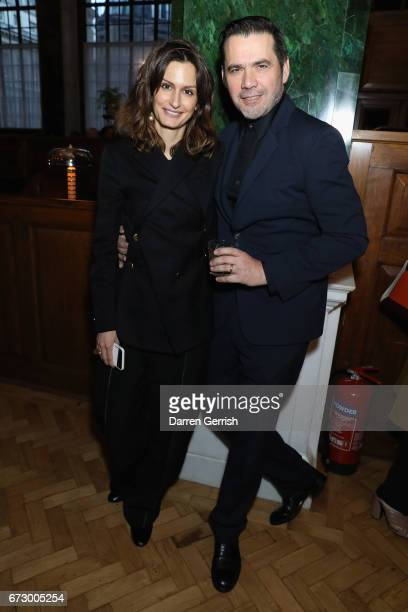 Isabelle Kountoure and Roland Mouret attend Roland Mouret's The Dinner of Love at Cecconi's a preopening dinner at The Ned on April 25 2017 in London...