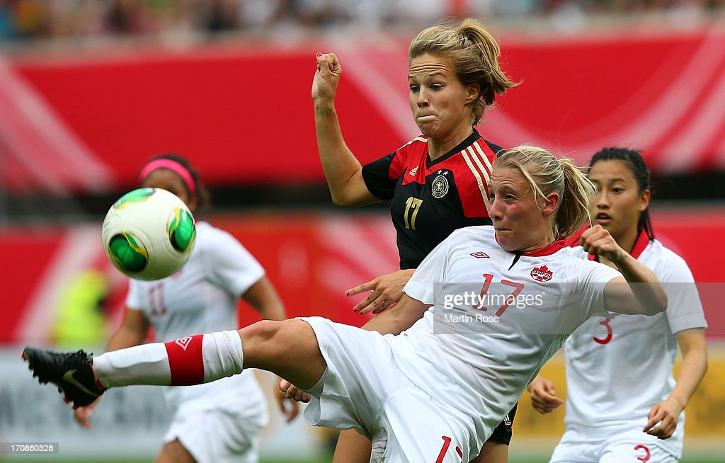 Isabelle Linden (back) of Germany and Melissa Busque of Canada battle for the ball during the Women's International Friendly match between Germany and Canada at Benteler Arena on June 19, 2013 in Paderborn, Germany.