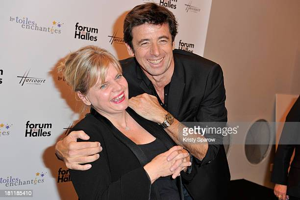 Isabelle Nanty and Patrick Bruel attend the 'Stars Parmi Les Stars By Studio Harcourt' Exhibition at Forum des images on September 19 2013 in Paris...
