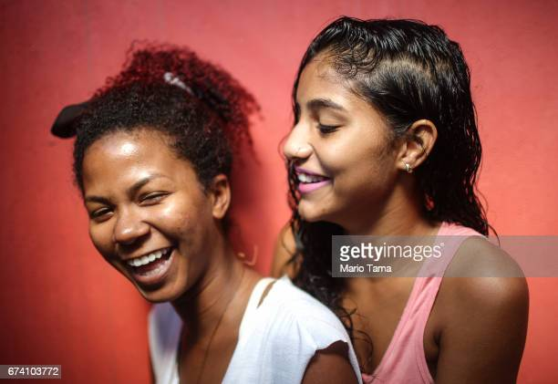 Isabelle Vieira da Rocha de Lucena and Jssica Corra Pereira laugh while posing on April 21 2015 in São Gonçalo Brazil