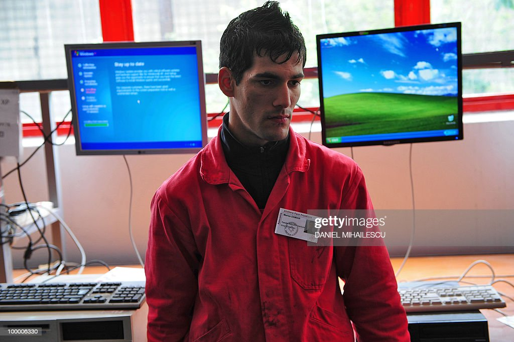 Isabelle Wesselingh -- Marius Damian, an employee of 'Atelieres sans Frontieres' (Workshops Without Borders) NGO stands next to his work station in Bucharest on May 18, 2010. In Romania, affected by an economic recession which is the worst in the European Union plus a high rate of unemployment, Workshops wihtout Borders is one of the only opportunities offering a possibility of return to work for people who are poor and homeless.