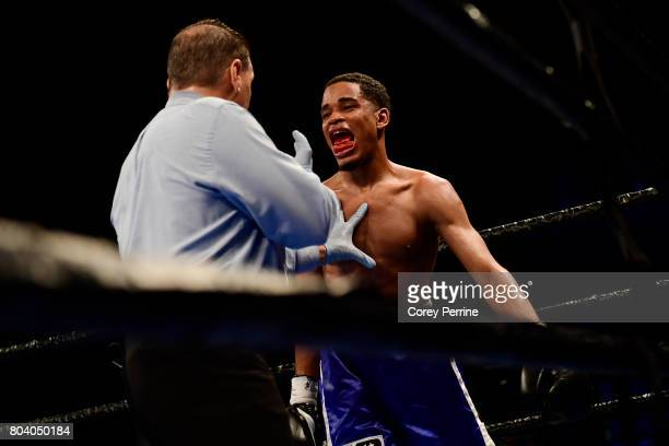 Isaelin Florian shows his mouth to the referee while fighting Avery Sparrow in the fourth round during a lightweight bout at the Sands Bethlehem...