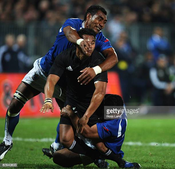 Isaia Tuiava of the All Blacks is tackled by Simaika Mikaele and Hiroshi Tea during the rugby test match between New Zealand and Samoa at Yarrows...