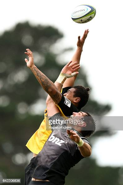 Isaia WalkerLeawere of the Hurricanes and Sam Whitelock of the Crusaders compete for a linout ball during the Super Rugby preseason match between the...