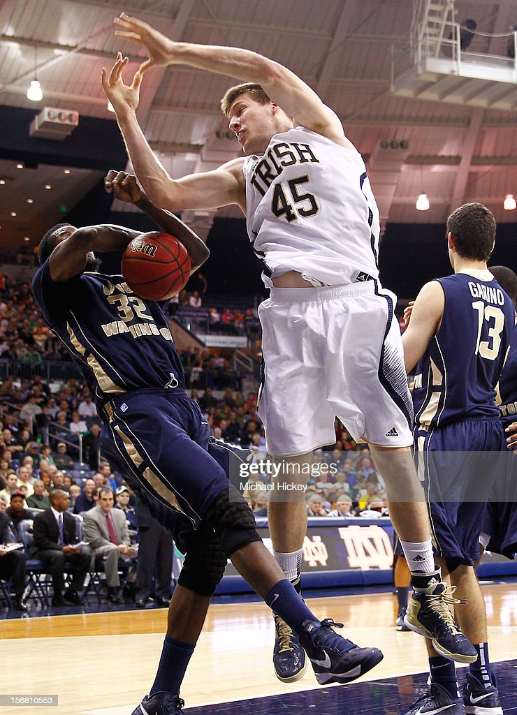 Isaiah Armwood #32 of the George Washington Colonials and Jack Cooley #45 of the Notre Dame Fighting Irish battle for a rebound at Purcel Pavilion on November 21, 2012 in South Bend, Indiana. Notre Dame defeated George Washington 65-48.