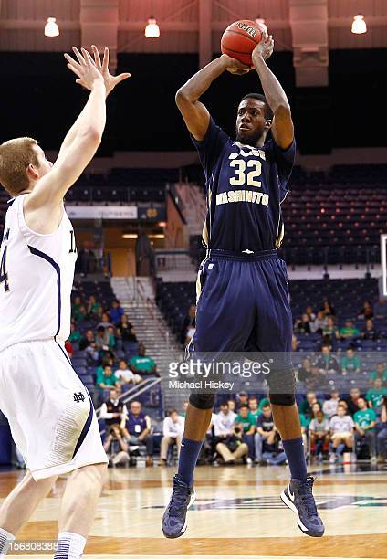 Isaiah Armwood of the George Washington Colonials shoots the ball against Scott Martin of the Notre Dame Fighting Irish at Purcel Pavilion on...