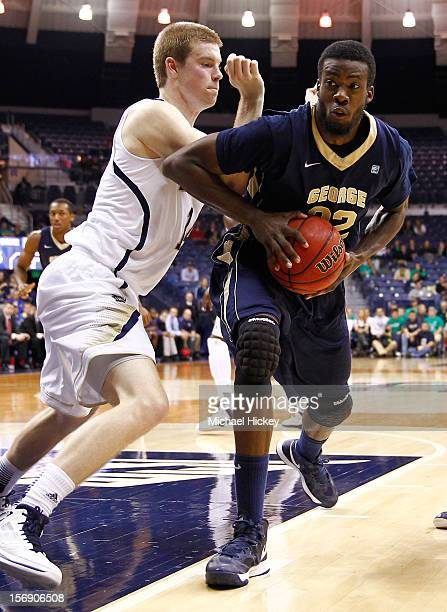 Isaiah Armwood of the George Washington Colonials tries to make a move to the basket as Scott Martin of the Notre Dame Fighting Irish defends at...