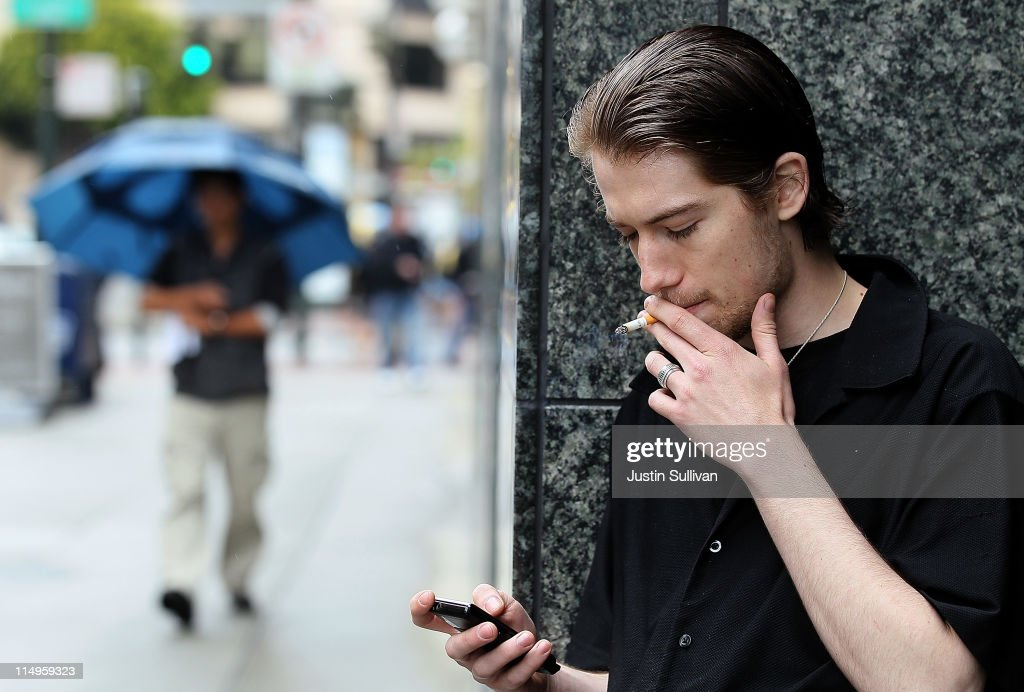 Isaiah Atkinson smokes a cigarette in front of the San Francisco Centre on May 31, 2011 in San Francisco, California. Since 1987, the World Health Organization has celebrated 'World No Tobacco Day' to raise awareness to the health risks associated with smoking tobacco. Smoking is the second biggest cause of death globally and is responsible for the death of one in ten adults worldwide.