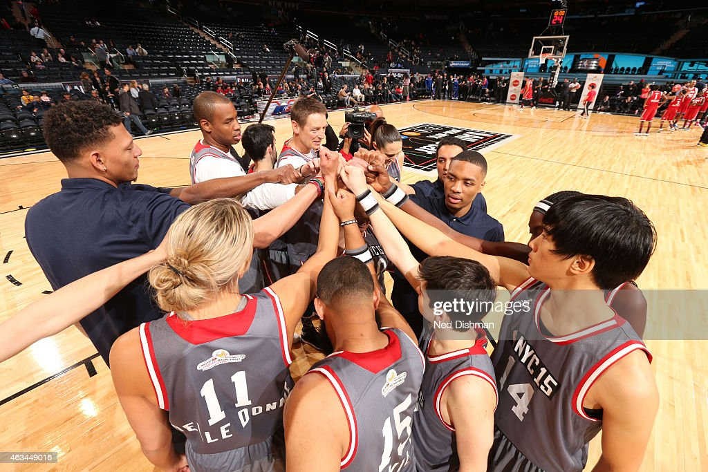 Isaiah Austin and the East team huddle during NBA Cares Special Olympics Unified Sports Game as part of 2015 AllStar Weekend at Madison Square Garden...