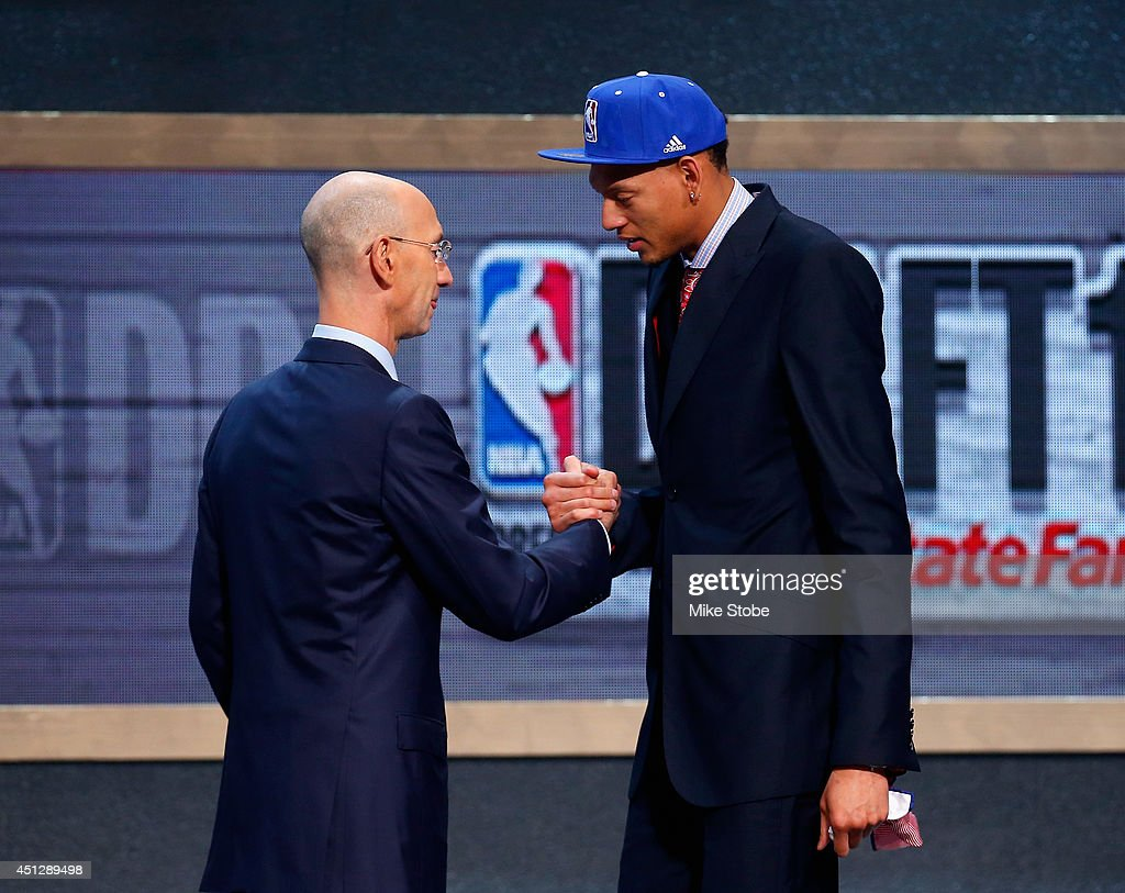 Isaiah Austin of Baylor is greeted by NBA Commissioner Adam Silver as he is honored on stage during the 2014 NBA Draft at Barclays Center on June 26...