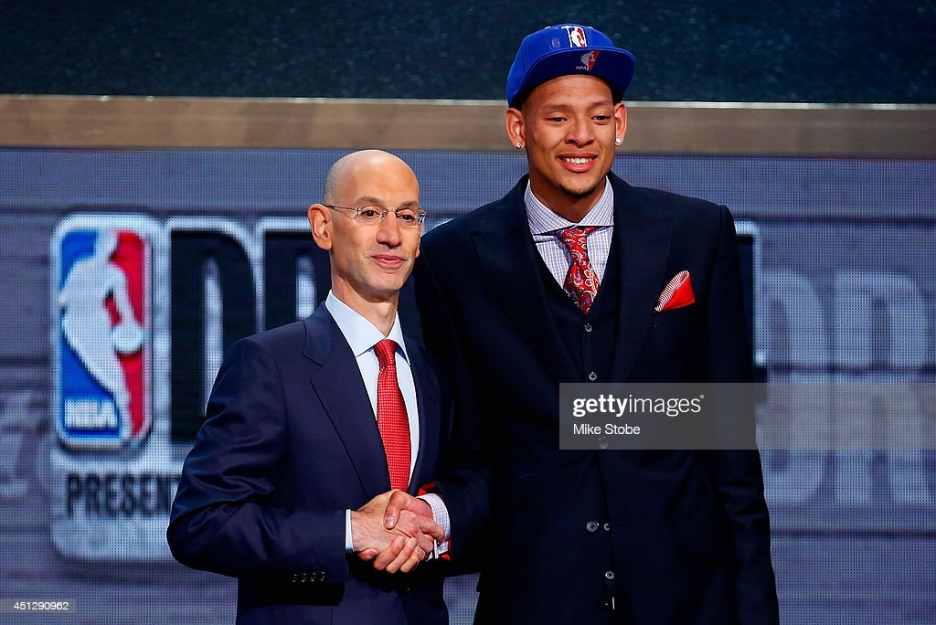 Isaiah Austin of Baylor shakes hands with NBA Commissioner Adam Silver as he is honored on stage during the 2014 NBA Draft at Barclays Center on June...