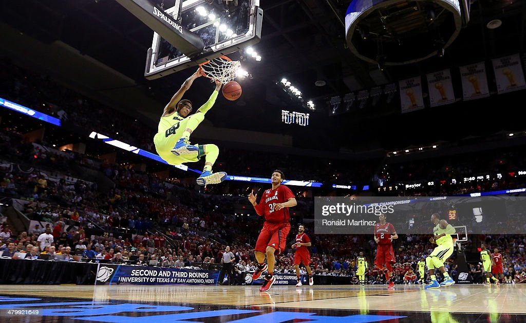 <a gi-track='captionPersonalityLinkClicked' href=/galleries/search?phrase=Isaiah+Austin&family=editorial&specificpeople=9082709 ng-click='$event.stopPropagation()'>Isaiah Austin</a> #21 of the Baylor Bears dunks in the second half against the Nebraska Cornhuskers during the second round of the 2014 NCAA Men's Basketball Tournament at AT&T Center on March 21, 2014 in San Antonio, Texas.