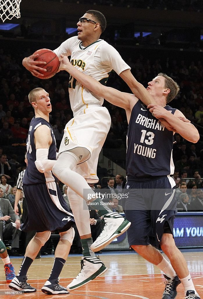 Isaiah Austin #21 of the Baylor Bears grabs a rebound from Brock Zylstra #13 of the Brigham Young Cougars in the second half during the 2013 NIT Championship - Semifinals at the Madison Square Garden on April 2, 2013 in New York City.