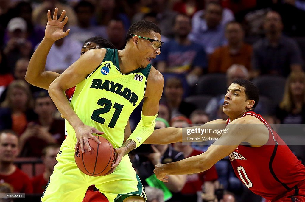 Isaiah Austin of the Baylor Bears handles the ball against David Rivers and Tai Webster of the Nebraska Cornhuskers in the first half during the...
