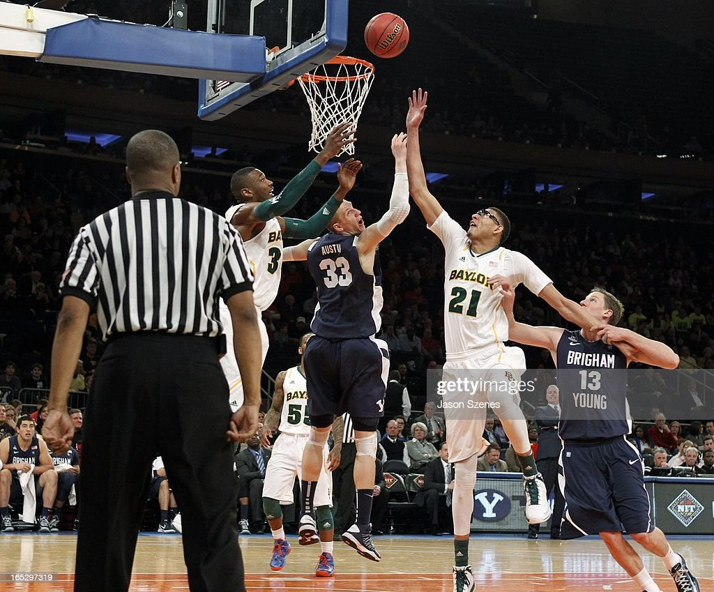 Isaiah Austin #21 of the Baylor Bears jumps for a rebound against Nate Austin #33 of the Brigham Young Cougars in the second half during the 2013 NIT Championship - Semifinals at the Madison Square Garden on April 2, 2013 in New York City.