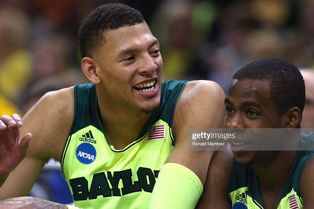 Isaiah Austin of the Baylor Bears looks on from the bench late in the game against the Nebraska Cornhuskers during the second round of the 2014 NCAA...
